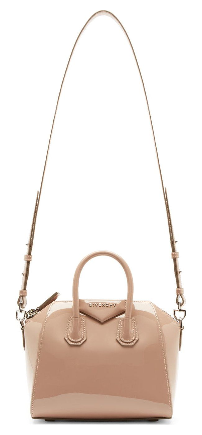Pink Patent Leather Antigona Mini Duffle Bag by Givenchy. Paten calfskin in dusty pink, silver tone hardware, roll carry handles, tonal leather shoulder strap, zip closure at main compartment, raised panel with metal logo in front, super gorgeous bag for any occasion. http://www.zocko.com/z/JJ6Qp