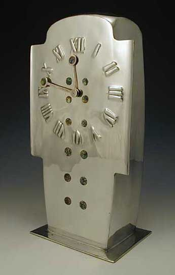 Archibald Knox (Designer)/Liberty & Co. (Manufacturer), Clock, polished pewter with abalone-insert decoration, England, ca. 1905. (Nice example of an Arts-and-Craft clock.)