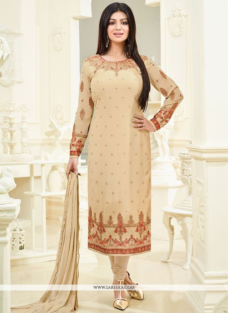 Pamper the women in you with this beautiful Ayesha Takia beige faux georgette churidar designer suit. This attire is showing some really mesmerizing and innovative patterns embroidered with embroidere...