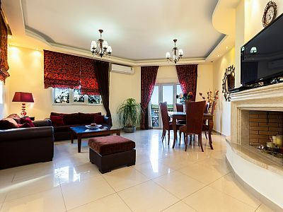 Rethymno villa rental - Open plan living room with dining area with views of the surrounding area!