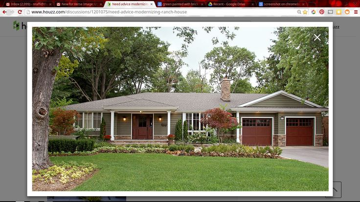 Green House Exterior With Off White Brick And Brown Details Ranch House Exterior Facade House House Paint Exterior