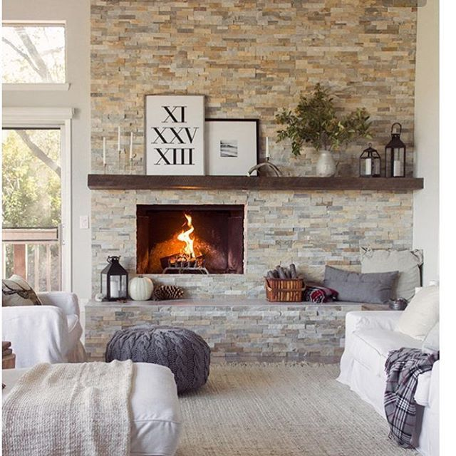 Working on a client's fireplace makeover and my own fireplace makeover. I keep coming back to this picture from the home of uber-talented @jennasuedesign. The wood mantel and stone make it feel cozy while the fireplace being off-center brings a modern feel. Serious perfection in this picture. #interiors #homedecor #inspiration #fireplace