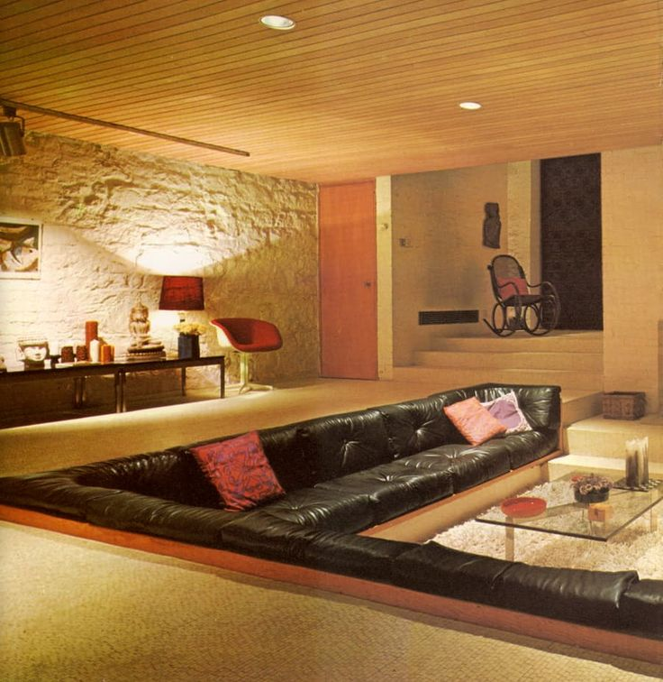 This 1971 living room, spotted in AnOther Mag, features a conversation pit, a common feature of the era.