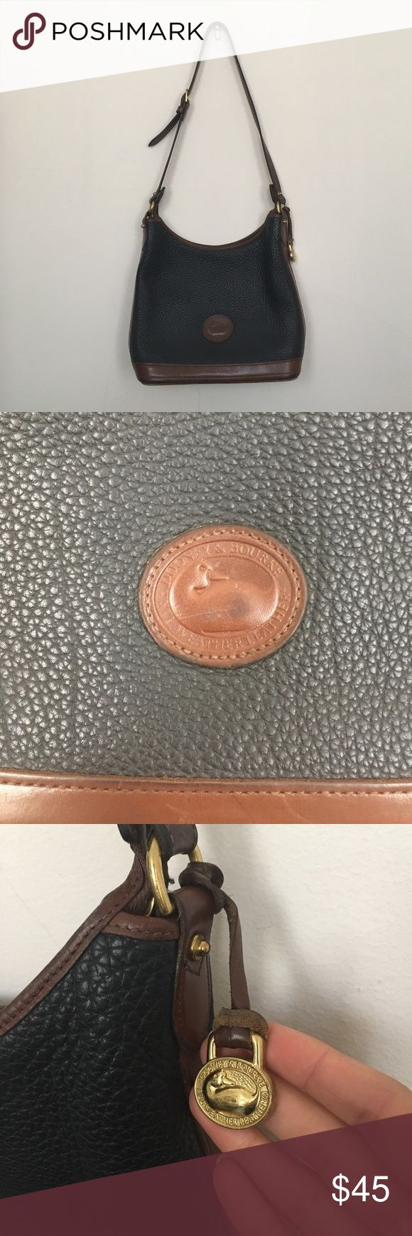 Vintage Dooney and Bourke navy purse The softness of the leather is incredible! In beautiful vintage condition.  Please see photos for condition. Dooney & Bourke Bags