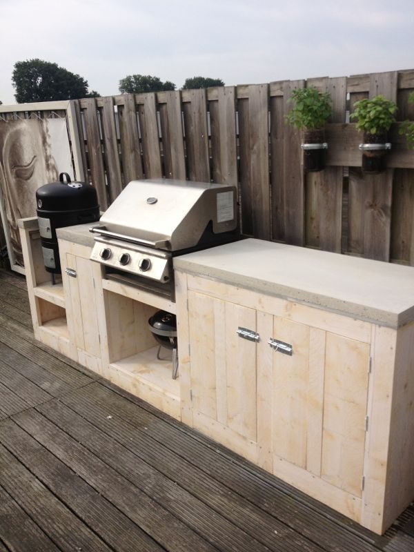 Not this but something like this to slot gas BBQ into for outdoor cooking. Hide the gas bottle too.