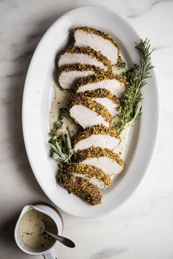 This pistachio crusted pork tenderloin has quickly become a favorite for our holiday dinner party. Paired with an herby, white wine , dijon sauce, it's hard to beat.