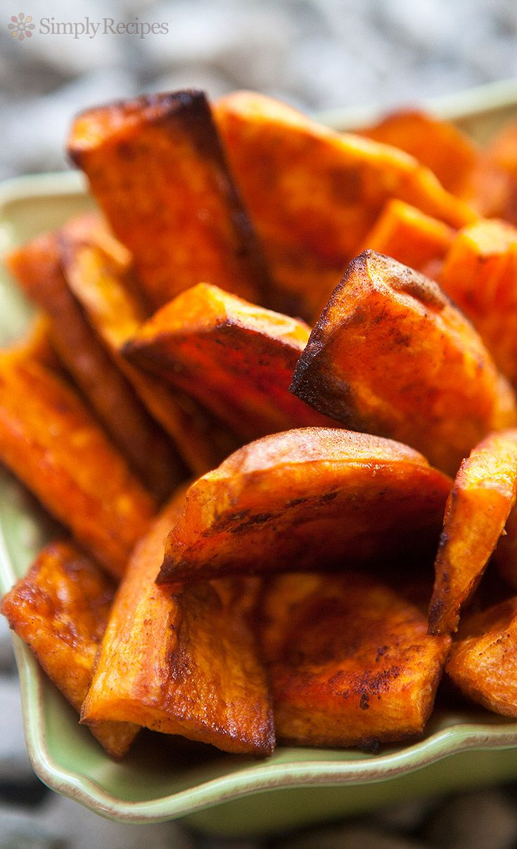 Oven Baked Sweet Potato Fries ~ Wedges of sweet potatoes, tossed in olive oil, sprinkled with spices, and baked on high heat until crispy and browned. Addictive! ~ SimplyRecipes.com