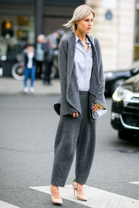 working at tiffany co Grey oversized knit trousers with matching grey cardigan The jacket is worn over a light blue shirt and finished with a blue bag Image via flare com