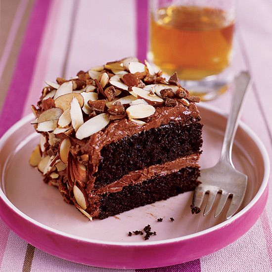 Toffee Almond Crunch Cake | With its layers of tender chocolate cake and chocolaty sour cream frosting, this dessert on its own is completely spectacular. But Patti Dellamonica-Bauler takes it one step further by covering it in toasted almonds and crushed toffee candy.