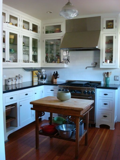 """bungalow kitchen remodel . Flush drawer and cabinet fronts, cabinets to the ceiling, small table as prep island. Wonder if my stove should be centered and flanked by cabinets like this kitchen. ? I like the tiny glassed in cabinets at the top. Is that too much glass for me? Probably too """"busy"""" for my kitchen."""