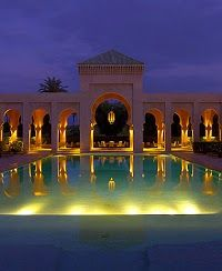 Amanjena Resort, Morocco. The Amanjena, meaning 'peaceful paradise', is a luxury hotel, 15-minutes from the ancient pink walled city of Marrakech on the Ouarzazate road.