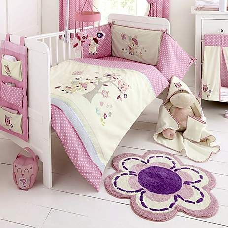 crafted from cotton this machine washable floral rug is coloured with shades of pink white and purple