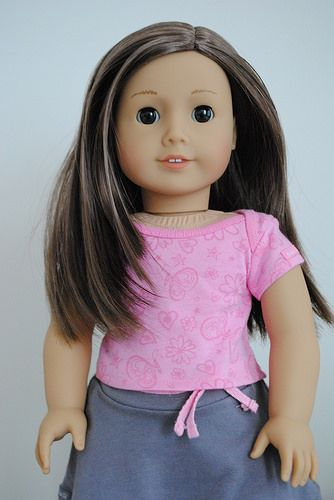 """Light skin, layered brown hair, brown eyes Your girl can create a unique personality for her My American Girl® doll! This doll is 18"""" tall, with brown eyes that open and close. She has light skin and"""