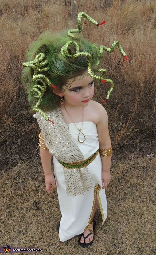 Carrie: My daughter Jailyn totally killed it Halloween night as MEDUSA! I made a traditional toga with some cream fabric, needle and thread just by folding over a yard and a...