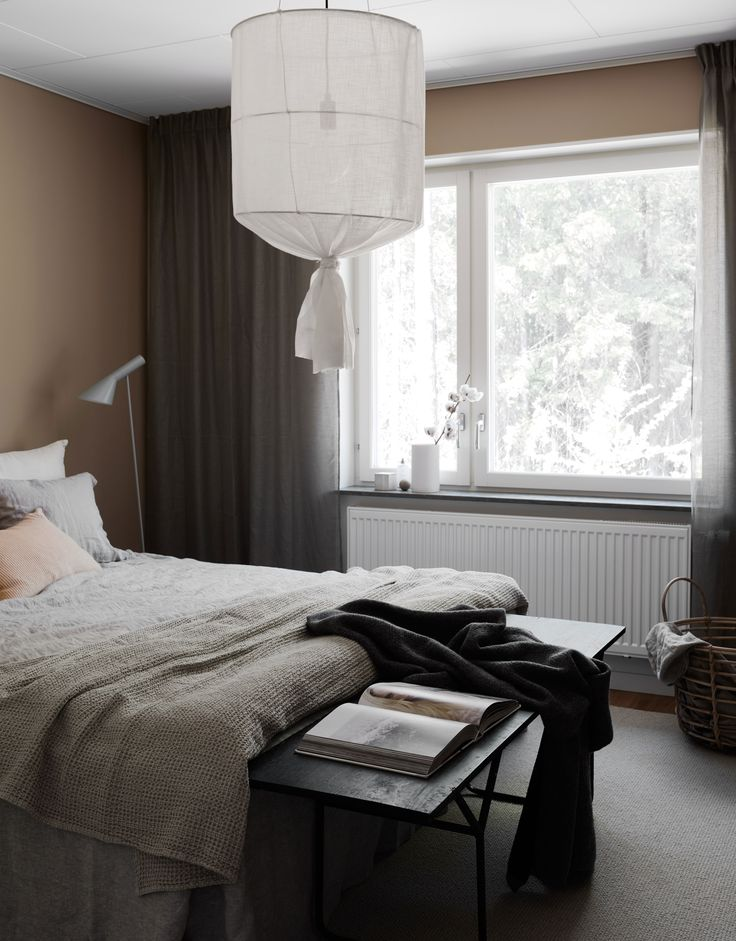 Stylist Pella Hedeby designed this JM model home is minimal, moody shades | minimal, layered Scandinavian bedroom in different shades of grey and taupe | Bemz bedskirt in Graphite Brera Lino