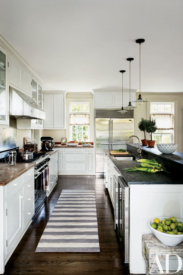 36 best kitchen faucets images on pinterest kitchen faucets tub a trio of pendant lights from laurin copen antiques hangs in the kitchen which is