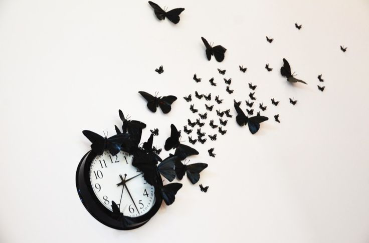 "Simple black wall clock is turned into a DIY Time Flies Clock with faux butterflies in our whimsical office space - Mr. Kate | DIY ""time flies"" butterfly clock"