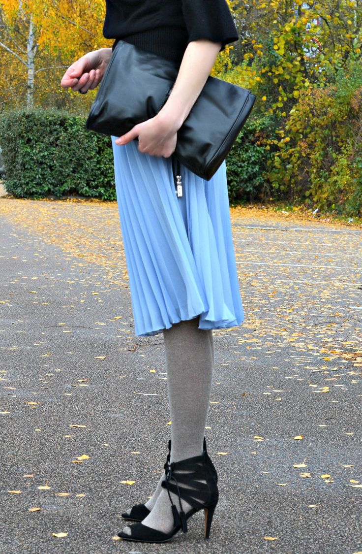 Black cashmere jumper paired with pale blue pleated skirt tights and lace-up sandals - Fashion over 40