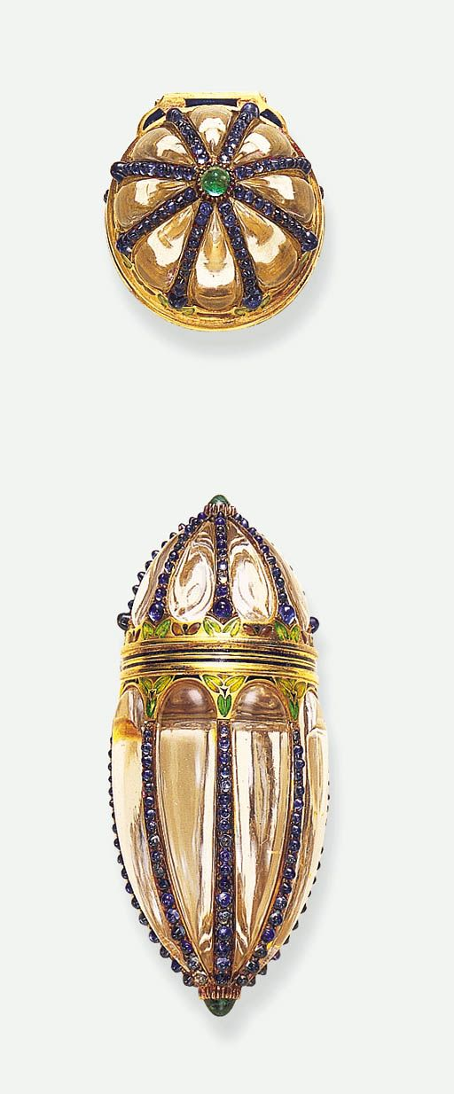 AN EXCEPTIONAL ROCK CRYSTAL AND GEM-SET SCENT BOTTLE, BY BOUCHERON - Designed as a fluted rock crystal perfume bottle, each flute set with graduated cabochon sapphires, enhanced by cabochon emerald terminals, to the green, blue and brown floral motif enamelled clasp opening to reveal a rock crystal stopper, mounted in gold, circa 1900