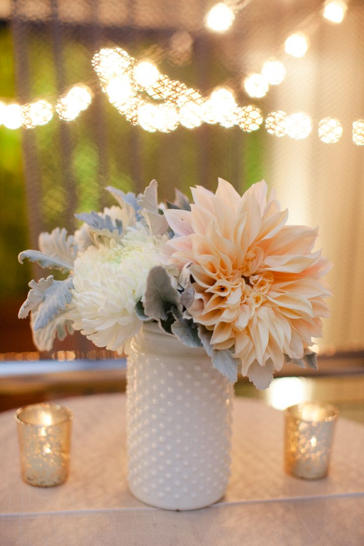 White and blush centerpiece. Dahlias, dusty miller, china mums, milk glass,