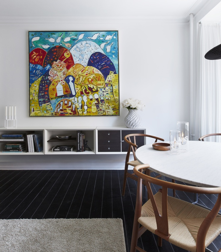 Painting by Ulrik Witt, Y-Chair in walnut by Hans J. Wegner, PK54 marble dinningtable by Poul Kjærholm. Wall Racking Boox-system by Jesper Holm. Scandinavian style interior in my small 635 sq. ft apartment, Copenhagen