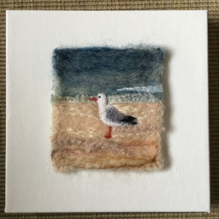 Needle felted scene mounted on a stretched canvas