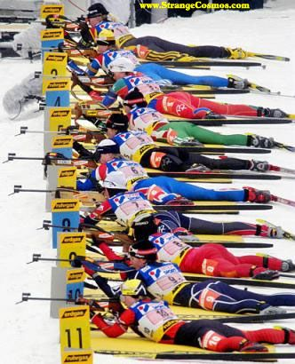 Competitors shoot during the women's 4 x 6 km relay World Cup biathlon race in Oberhof, Germany, Friday Jan. 10, 2003. Germany's Olympic championship team rallied Friday to win