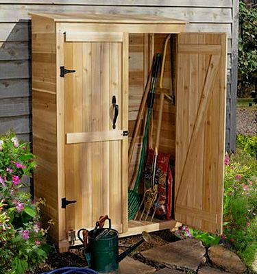 Simple Tool Shed for lawn tools, for more suggestions check out http://portablebuildingsdesigns.com