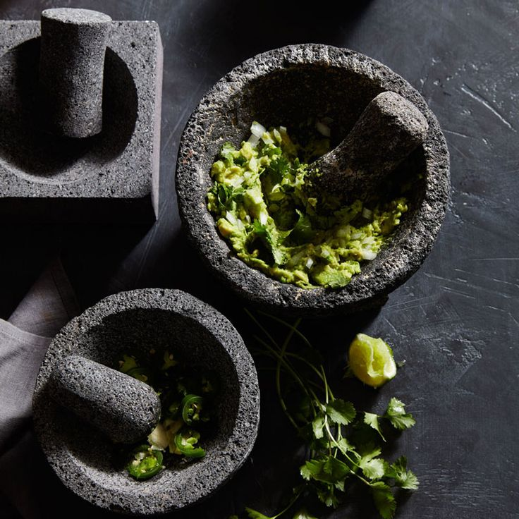 The secret to the perfect guacamole is using a traditional molcajete, a mortar and pestle made from volcanic rock.