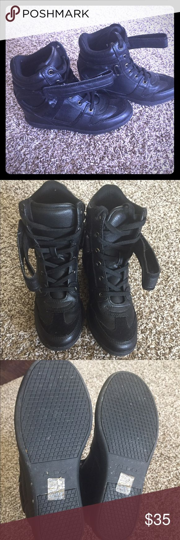 """Aldo hidden wedge sneakers All black wedge sneakers. Comfortable and stylish. Worn about 5 times; everything in good condition! Lace up, and strap in the front for tightening! Wedge is about 2"""". Aldo Shoes Sneakers"""