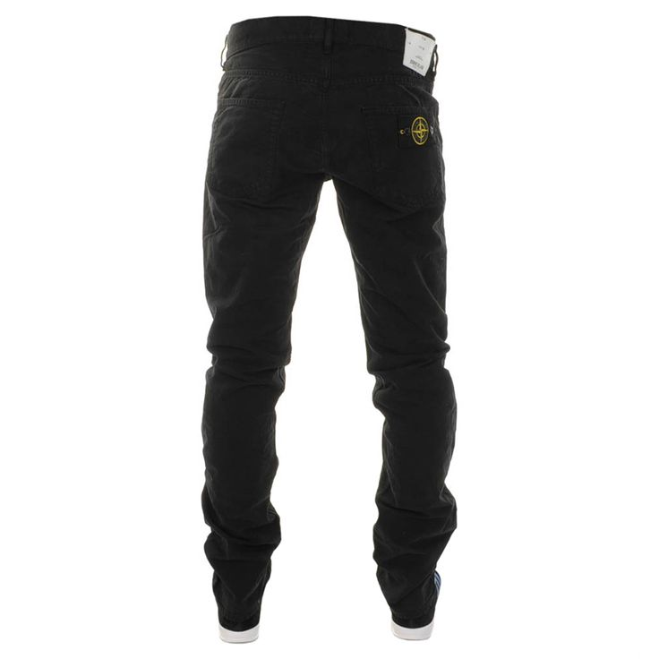 Stone Island Slim Jeans In Black, A full dark metal Stone Island logo embossed button fly and five belt loops on the waistband. Traditional five pocket design with a small coin pocket within the right waist pocket and dark metal logo embossed rivet detail for reinforcement. The Stone Island woven logo patch is on the coin pocket in black and white with the signature white leather Stone Island logo patch featured on the reverse right side of the waistband. High shine black logo embossed…