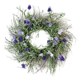 This beautiful lavender garden wreath will remind you of a field full of lavender, covered with different shades of purple and white flowers. It is accented with greenery on a grapevine wreath.