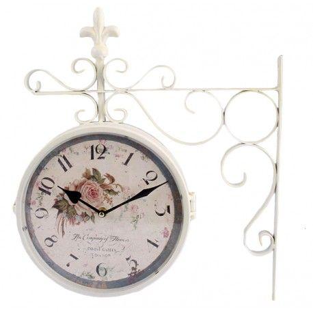 Prześliczny biały zegar dwustronny z motywem róży na tarczy. Delikatny i elegancki dodatek.