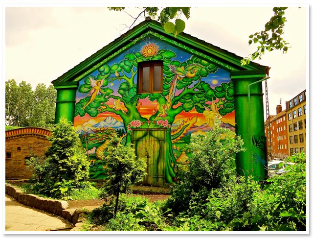 """A mural adorns a wall in Copenhagen's """"free zone"""" of Christiania. Founded in 1971, the 84-acre enclave is perhaps the largest and longest-lasting commune in history."""