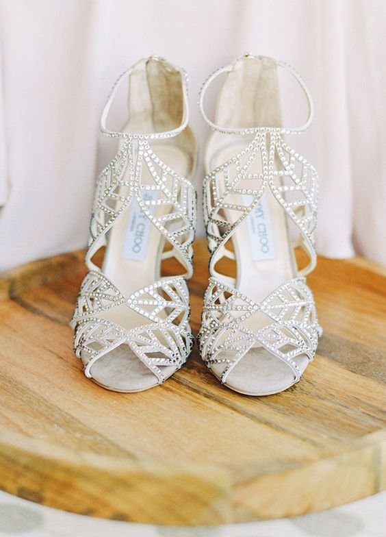 Featured Photographer: Jessica Lorren Photography; Elegant silver Jimmy Choo wedding shoes with unique cutout designs;
