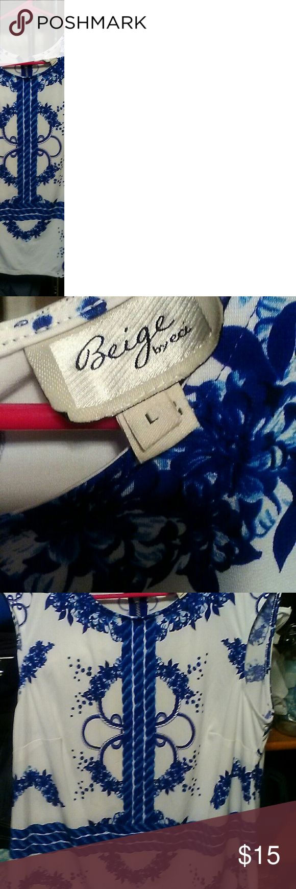 Blue and White Blouse Blue and white. Size Large, sleeveless top. Tops Blouses