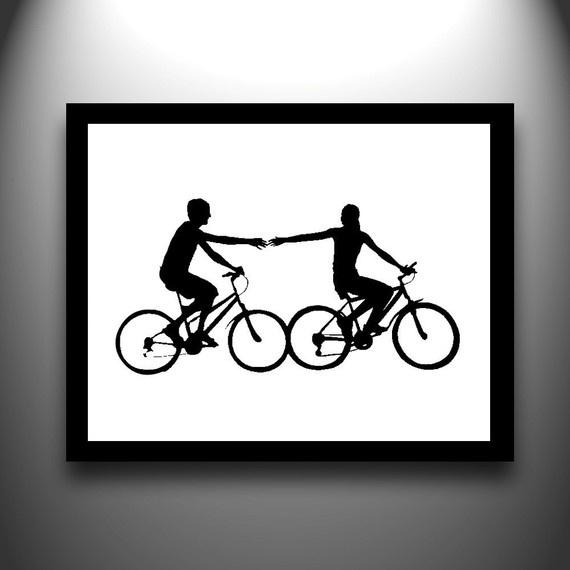Hand cut paper silhouette bike couple