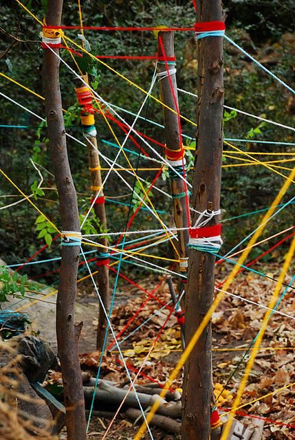 outdoor stick sculpture with  yarn/string