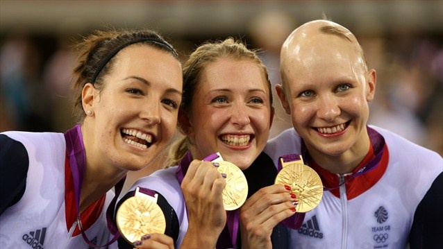 (L-R) Dani King, Laura Trott, and Joanna Rowsell of Great Britain pose with their Gold medal in the medal ceremony for the Women's Team Pursuit Track Cycling Finals after breaking the World Record on Day 8
