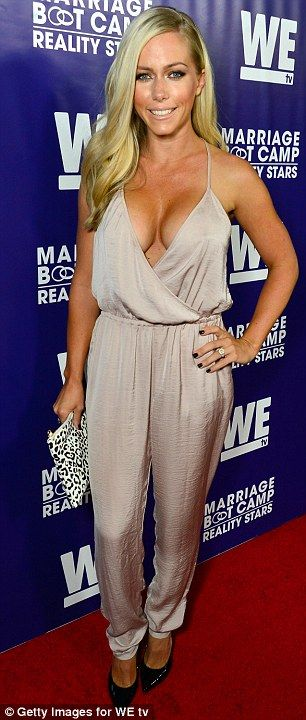 She's got some front! Kendra Wilkinson turns up to Marriage Boot Camp premiere in plunging...