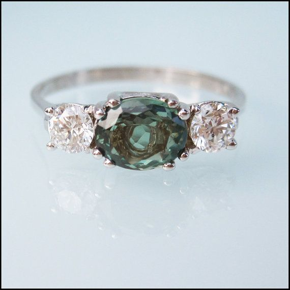 Unconventional engagement ring with natural Alexandrite and beautiful diamonds.