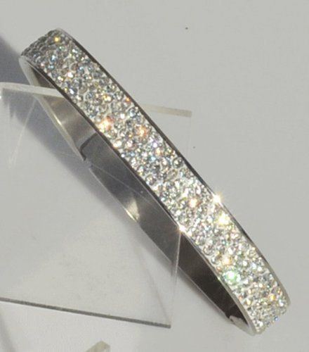 Hindged Bangle: with 4 Rows of Beautiful Sparkly Crystals - Clear - 9mm in width Sophistikitty. $21.99. To find the matching earrings set, type the Color you are interested in into the Sophistikitty search. Stainless-Steel. Extra stunning when stacked with multiple bangles. 9mm in width. Matching Earrings and Pendant available