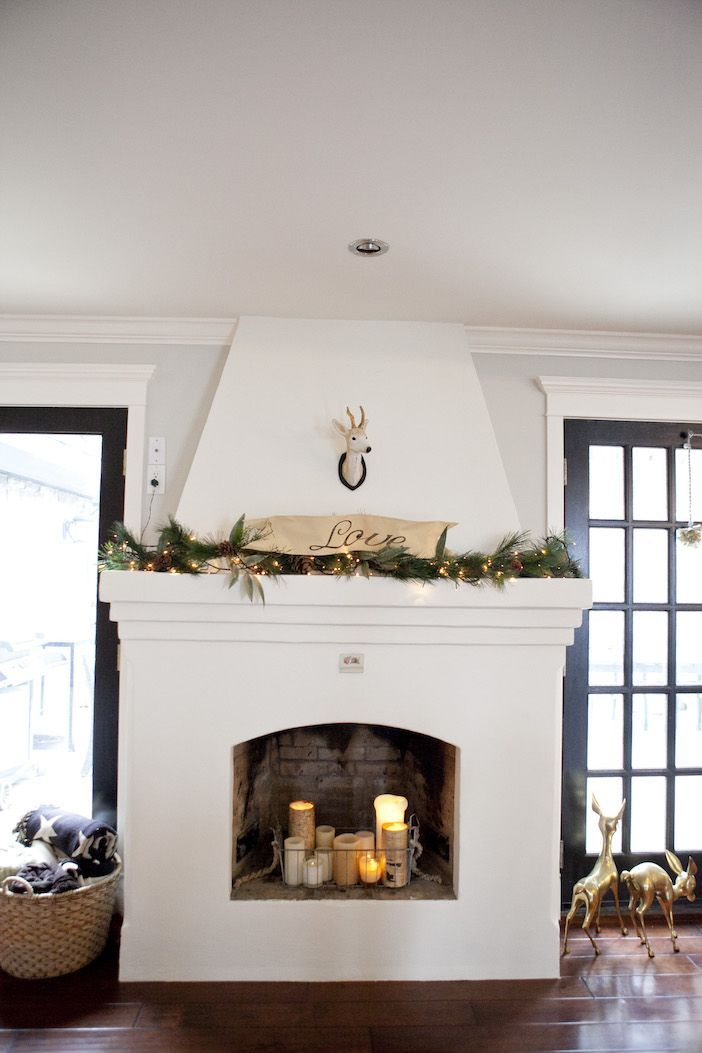 Try adding candles in your fireplace ... cozy glow without the mess!! XO