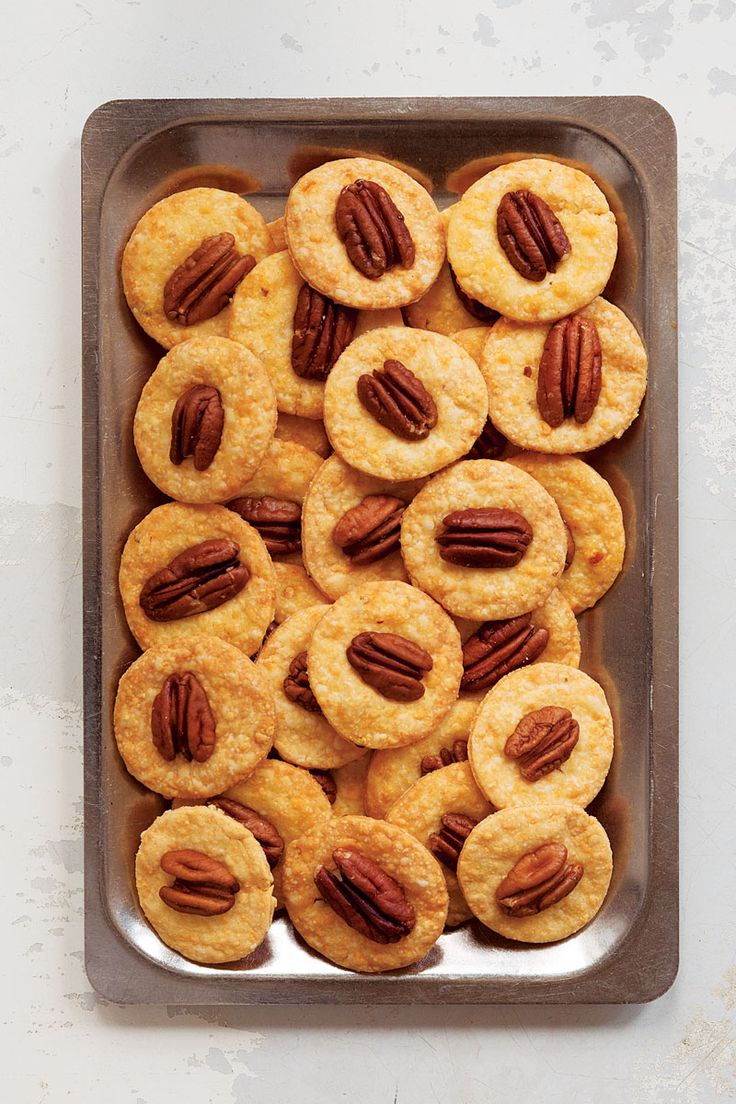 Perfect for a party! Pecan cheese wafers with chili flakes.
