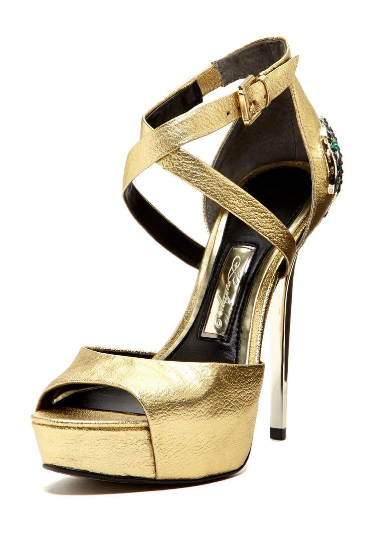 gold stilettos <3