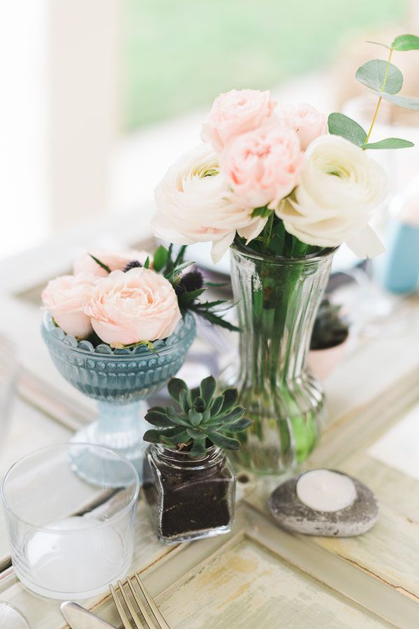 pink and white centerpiece with succulent plants