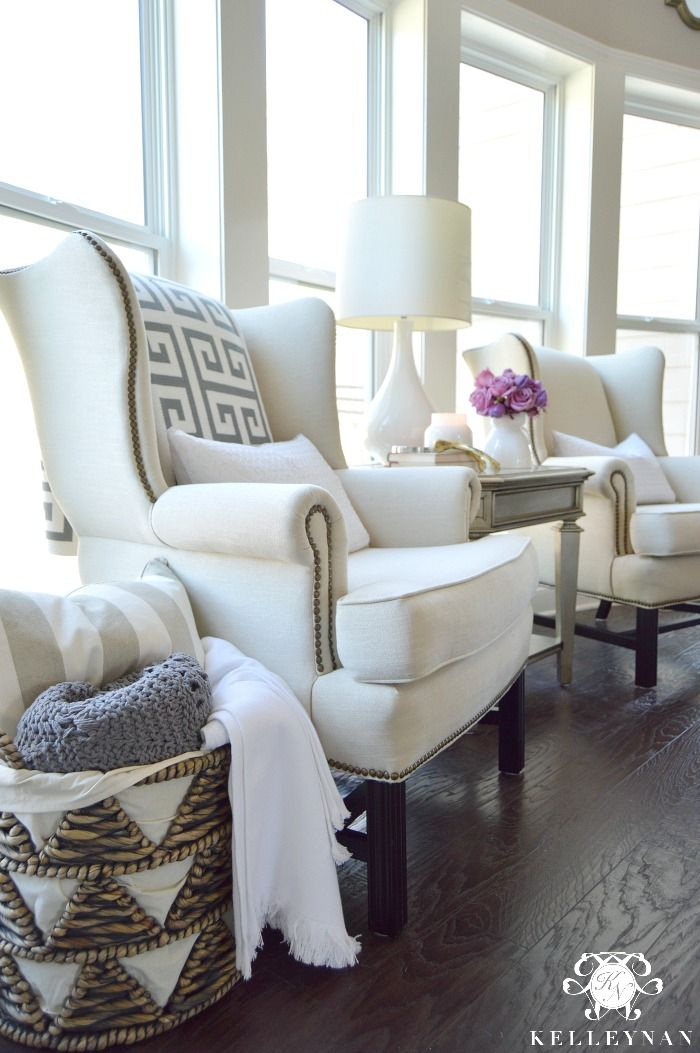 I Like the Pottery Barn Upholstered Thatcher Wingback Chairs in Living Room and the pillows