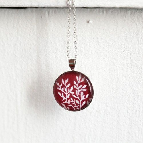 Silver pendant necklace with linocut illustration of red foliage by Yamok