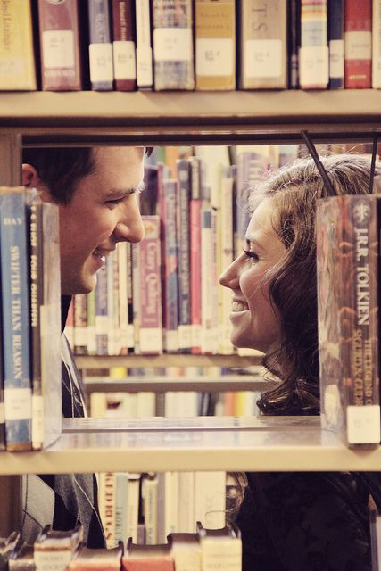 "engagement shoot in the library. Oh, oh! Or you could do a ""re-enactment"" of the place you met! You doing something while he watches or vice versa, running into each other, whatever it was that happened!"