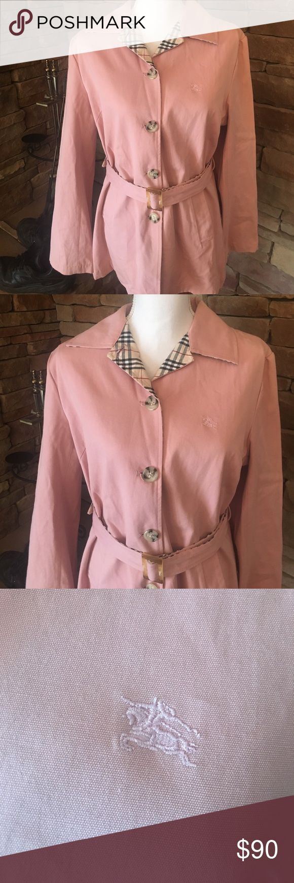"Burberry Blue Label Jacket Baby pink with Nova check collar, belt and down the row of buttons on the interior.  The belt is reversible. I ordered this thru and online consignment shop.   If this fit me I would NOT be selling.  😂.  Belt is reversible.   4 button closure, 3 buttons on each sleeve.   The size tag has been removed and since this is a Japan release all care instructions are in their language.     🎀 pit to pit: 20"" 🎀 shoulder to hem: 27"" 🎀 waist is 18"" 🎀 sleeves: 23"" L   All…"